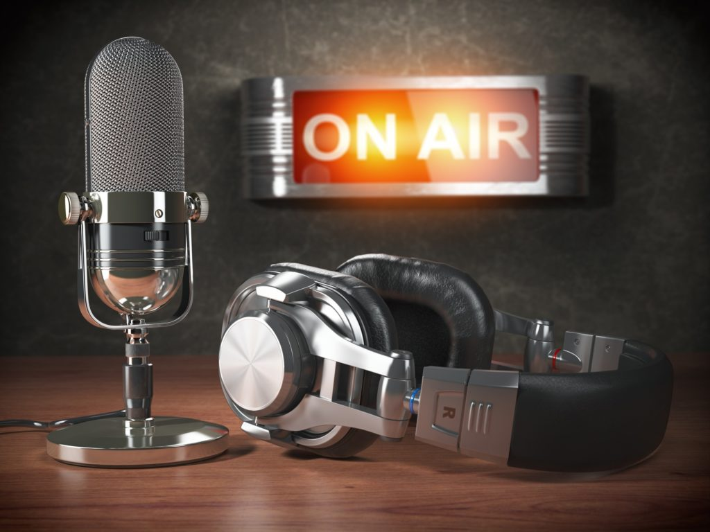 Vintage microphone and headphones with signboard on air. Broadc